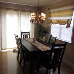 Simple Dining Room Wooden Furniture Set With Small Chandelier And Cream Color Of Window Curtains And Door Curtains