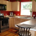 Simple Red And Wood Color Of KItchen With Hardwood Floor And Rug Accessories