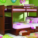 Simple wood bunk with stairs and storage system a colorful bedroom rug with multicolor flower pattern