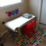 Small craft table for kid with small red plastic chair colorful polka dots area rug