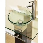 Small round glass vessel sink idea with stainless steel faucet
