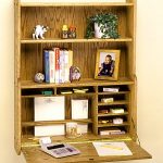 Solid wood folding desk with shelving unit mounted on wall system