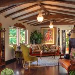 Spanish Style In Living Room With Showing Beams Double Classic Lighting Sofas Classic Carpet And Frames