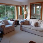 Spanish Style Living Room With White Sofas Carpet Pillows Standing Lamp ANd Big Windows