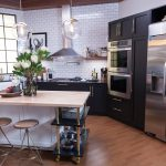 Stainless Steel Kitchen Set With Big Refrigerator And Stylish Lamps Wood Kitchen Table With Flower Accessories