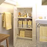 Tall bathroom cabinet organizer with yellow stoarge boxes as the additional storage