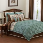 Teal and brown bedding with teal and brown teal and brown color dark brown wooden side table with a table lamp a bed furniture with classic style headboard