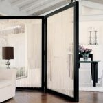 Temporary room partition with black wood frame