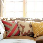 Three decorative pillows for couches with modern and floral patterns