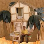 Tropical-Tree-House-Bunk-Bed-with-ladder-and-on-light-wooden-floor