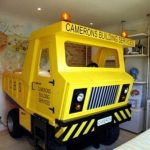 Truck-bed-design-and-for-kids-in-yellow-color-with-camerons-building-service-car-design-near-white-cabinet