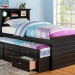 Trundle bed with drawers and bookcase in headboard grey shaggy bedroom rug