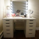Two Parts Of Drawers On White Makeup Vanity Table With Lights