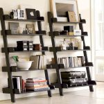 Two units of leaning shelves in black stain