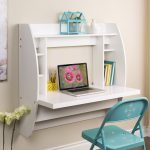 Wall mounted fold desk with bookcase a blue chair