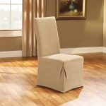 Warm Color Slipcovered Chair Brown Curtain And Wall With Hardwood Floor