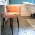 Warm light orange vanity chair with low backrest in modern style