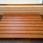 Weightlight wood mat for outdoor area of shower space