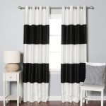 White And Black BLackout Curtains With Chair Pillow Small Table And A Drawer And Lamp