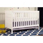 White Baby Crib With White Mattres Blue Decorative Rug
