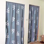 White Leaf And Blue Color Of Curtains Door With Two Different Rugs
