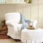 White Slipcover Chair And Table With Cool Rug