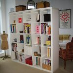 White finished open book rack as room divider