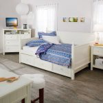 White painted wood daybed with under storage idea blue bed cover white pillow and  two decorative pillows with blue pillowcase