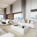 Whte Living Room In Luxury Style With High Ceiling And Long Curtains White Furniture