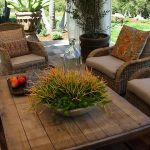 Wood planks coffee table for patio a set of patio chairs with cushions and decorative pillows