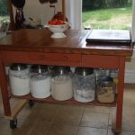 Wooden Kitchen Island With Big Jars Inside
