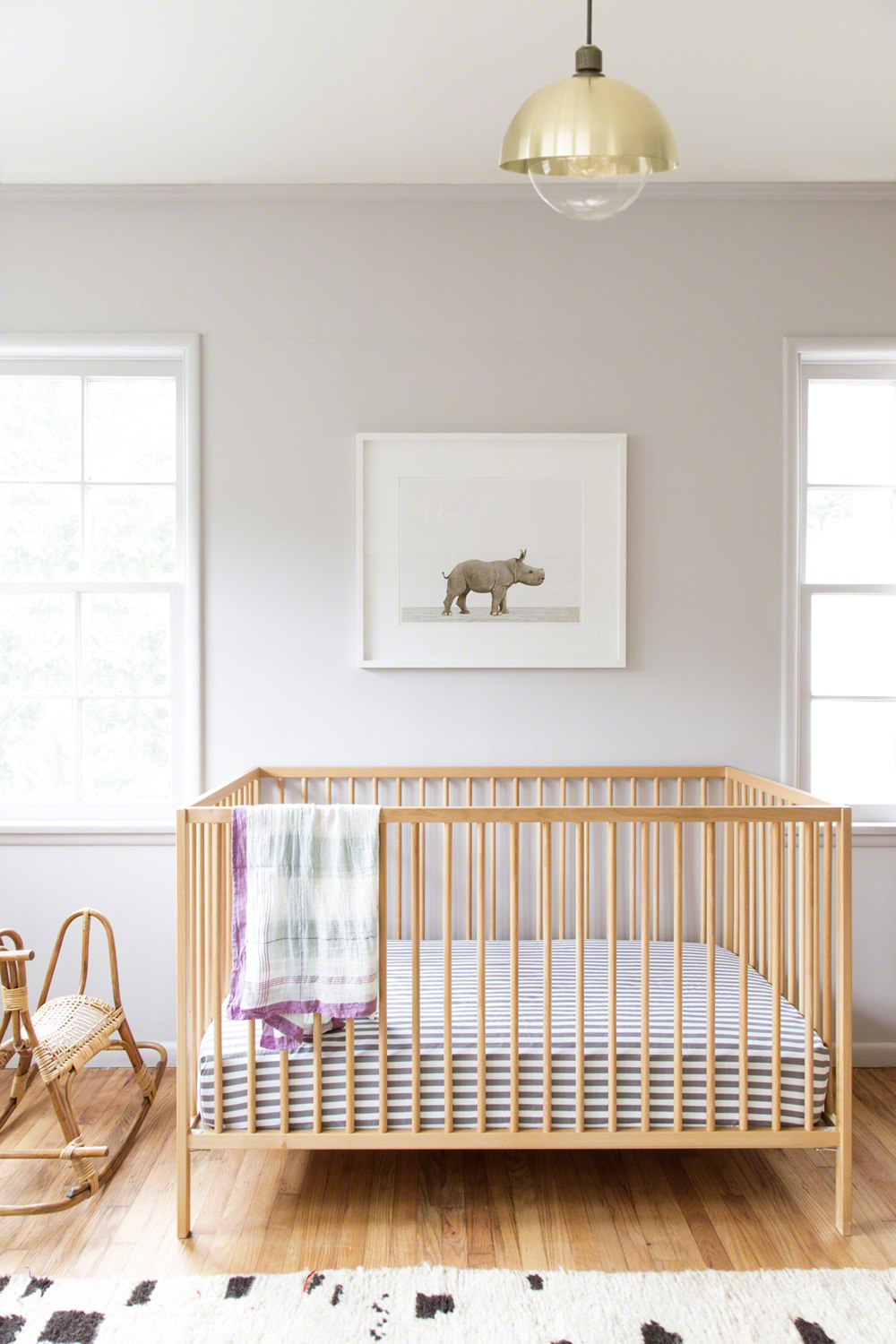 Wooden Baby Crib With Bedding A Pendant Lamp Rocking Horse