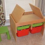 Wooden craft table for kids a pair of chairs for kids in bright blue and green colors four plastic boxes as storage units