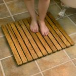 Wooden mat for shower space
