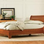 Wooden sleigh bed furniture with headboard and no footboard feature