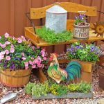 adorable and cheerful garden decoration idea with wooden racks and low growing flower and planter and bench and stone yard