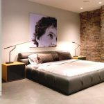 Adorable And Elegant Bedroom With Loft Idea With Gray Bedding And Brick Wall Accent And Wall Picture And Wooden Nightstand