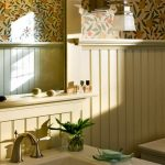 Adorable Bathroom Idea With Floral Wallpaper And Yellowish Beadboard And White Vanity Sink And Potted Plant And Curved Faucet