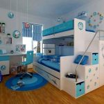 adorable bedroom idea with blue low profile bunk bed and storage and wooden floor and blue rug and desk and glass window