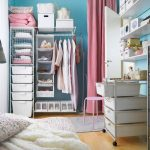 adorable blue pink laundry room with basket shelves idea on wooden floor with wardrobe storage and blue wall and floor lamp