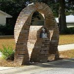 adorable brick mailbox idea with arched style and bird cage shaped box and road and yard