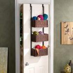 adorable brown over the door rattan basket storage design for wool on white door aside gray concrete siding with palette
