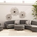 adorable curved gray sectional sofa with chaise idea with white cushions and round pouff cofee table and wallpaper and indoor plants