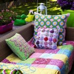adorable gray sofa design with colorfl throw and patterned cushions with duck and potted plants