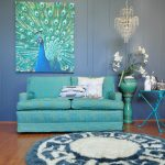 adorable interior design with turquoise velvet fabric sofa with white cushion and chandelier and peacock picture on the gray wall with blue furry patterned area rug