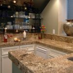 adorable loft kitchen design with sloping ceiling and white cabinetry with river gold granite idea with wine glass storage and pottery