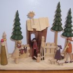 adorable modern nativity set idea with pien tress and church and some people
