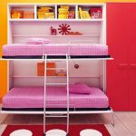 adorable pink red and yellow convertible bunk bed idea with storage and red polka dot area rug