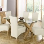 adorable rectangle all glass dining table design with white chairs slipcover and wooden floor and large glass window and white paint wall