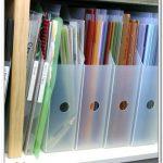 Adorable Semi Transparent Plastic Scrapbok Paper Organizer Idea On Rack With Small Hole